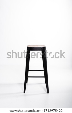 Wooden chair with black long legs on white background. #1712975422