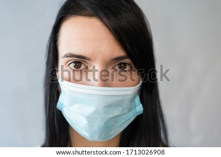 European woman wearing surgical mask and gloves for medical care. Face expressions for pandemic concern #1713026908