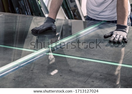 glazier breaking glass on a professional table Royalty-Free Stock Photo #1713127024
