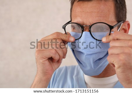 Medical mask and Glasses fogging. Coronavirus prevention, Protection. Male doctor portrait close up Royalty-Free Stock Photo #1713151156