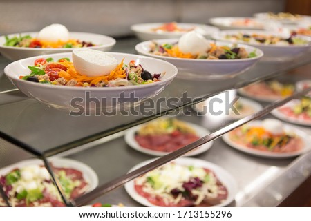 Close up on canteen food resting on a table top, no people are visible. Royalty-Free Stock Photo #1713155296