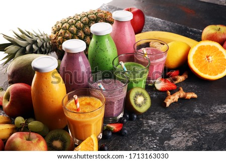 Assortment of fruit smoothies in glass bottles. Fresh organic Smoothie ingredients. Smoothies for health or detox diet food concept. #1713163030