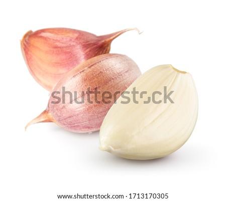 Garlic cloves on white. Garlic clove isolated. Peeled, unpeeled garlic cloves. #1713170305