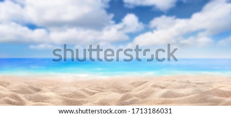 A summer vacation, holiday background of a tropical beach and blue sea and white fluffy clouds. #1713186031