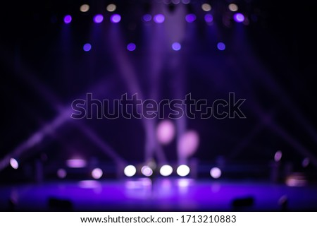 Texture blur and defocus, background for design. Stage light at a concert show. Royalty-Free Stock Photo #1713210883