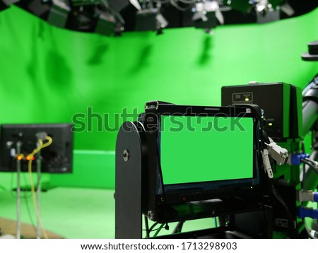 camera monitor of professional studio camera with virtual greenscreen at TV station.