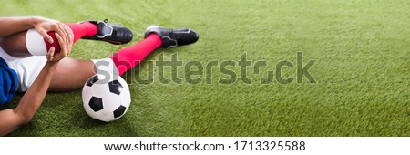 Soccer Player African American Athlete With Sport Knee Injury #1713325588