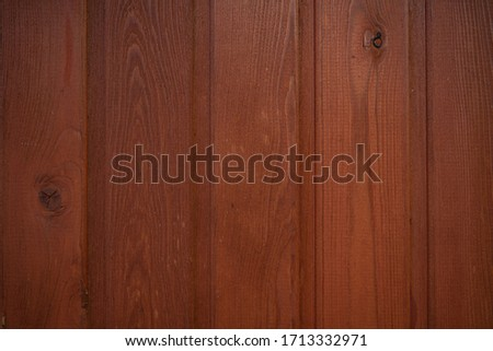 Mahogany texture. Wooden plank. Wall made by wood. Background image of the wall of a wooden house. Fiber wood. A closeup. Background for text. Space for text. Top view. Desktop wallpaper. #1713332971