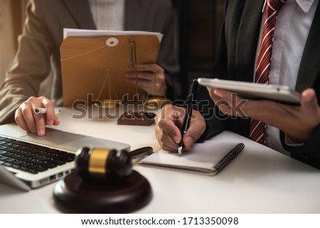 Businessman and Male lawyer or judge consult having team meeting with client, Law and Legal services concept. #1713350098