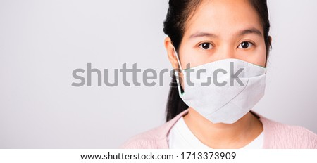 Asian beautiful woman wearing protection face mask against coronavirus her looking to camera, studio shot isolated on white background with copy space, COVID-19 or corona virus concept #1713373909