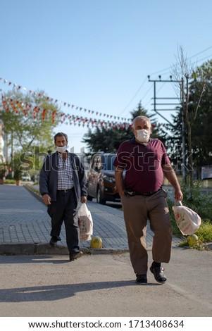 Bursa/Turkey - 24.04.2020 : Old man buying bread on the first day of Ramadan #1713408634