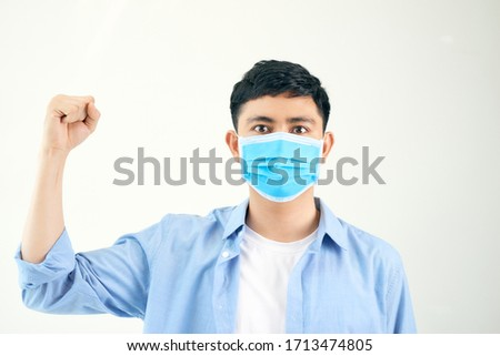 Young man rejoicing his success and victory clenching his fists with joy. #1713474805