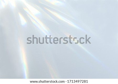Blurred overlay effect for photo and mockups. Wall texture with organic drop diagonal shadow and rays of light on a white wall. shadows for natural light effects #1713497281