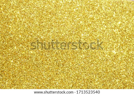 gold glitter lights texture bokeh background Christmas Royalty-Free Stock Photo #1713523540
