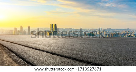 Empty asphalt road and Chongqing city skyline and buildings at sunset,China. Royalty-Free Stock Photo #1713527671