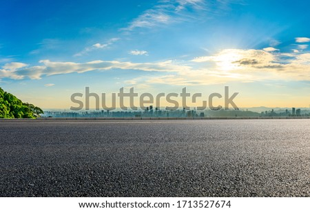 Empty asphalt road and Chongqing city skyline and buildings at sunset,China. #1713527674