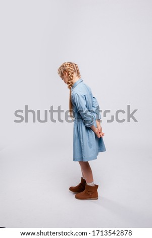 young girl with long hair turned her back
