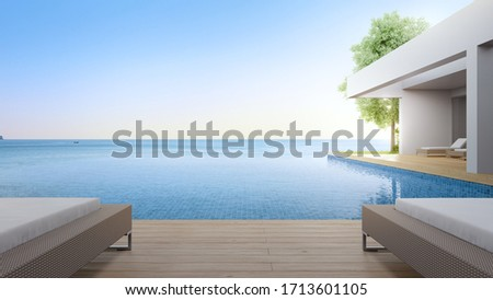 Lounge chair on terrace near swimming pool and garden in modern beach house or luxury villa. Building exterior 3d rendering with sea view. #1713601105