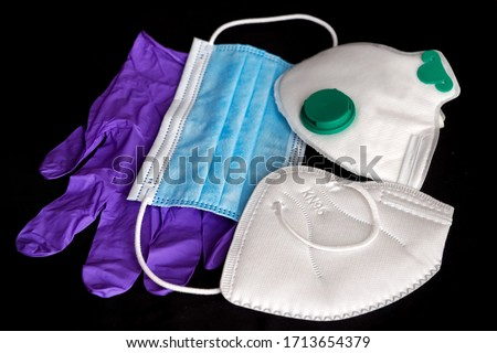 Surgical mask, medical masks FFP2 / FFP3 / N95 / KN95 and gloves for protection against diseases, virus, flu, coronavirus COVID-19. Personal protective equipment PPE. Different types of face mask.  Royalty-Free Stock Photo #1713654379