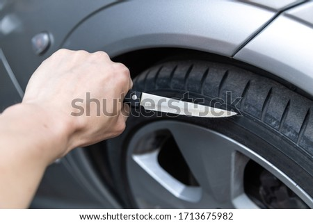 car tire smash with knife stuck in mature #1713675982