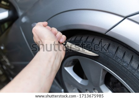car tire smash with knife stuck in mature #1713675985