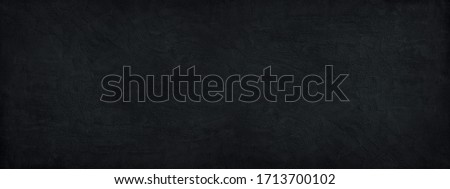 Black stone background. Black banner with concrete wall surface texture.