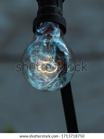 Glowing bulb with smoke effect #1713718750