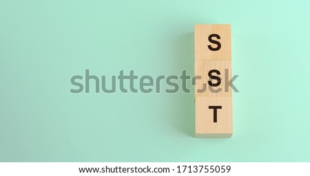 vertical row of wooden blocks with sst inscription business taxation concept #1713755059