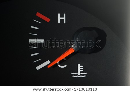 The car's coolant temperature indicator on the dashboard, a little color, shows the minimum temperature.