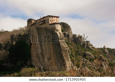 Meteora Kalabaka Greece. Orthodox monastery on top of a rock. Mountains. White broken clouds #1713905905