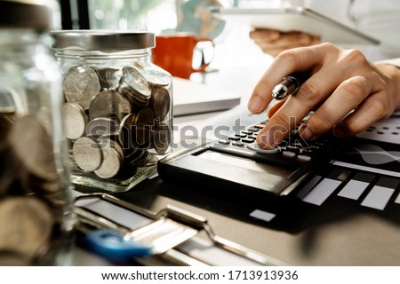 Healthcare costs and fees concept.Hand of smart doctor used a calculator for medical costs in modern hospital #1713913936