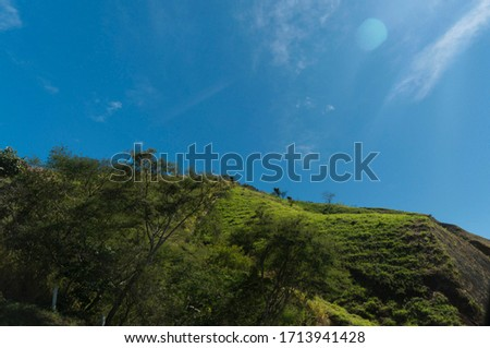 colorful landscape with blue sky and green areas #1713941428