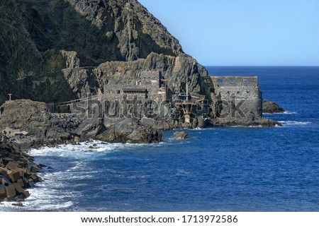 Castillo del Mar on the coast of Vallehermoso in the north of the island of La Gomera, Canary Islands, Spain - former port facility with banana loading station #1713972586