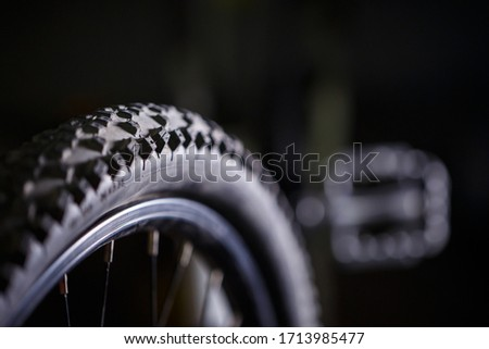 Black rubber tire with spikes for a bicycle wheel. Bike accessories #1713985477