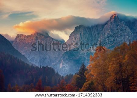Triglav mountain peak at sunrise with beautiful clouds in morning light. Slovenia, Triglav National Park