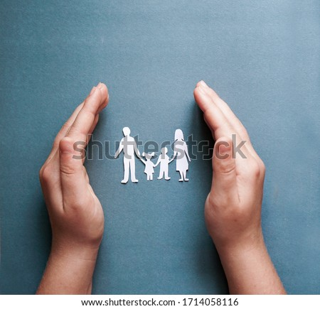 hands holding paper family cutout, social distancing concept, covid19  on the blue color background, family protection #1714058116