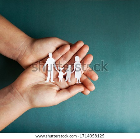 hands holding paper family cutout, social distancing concept, covid19  on the blue color background #1714058125