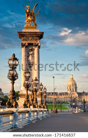 Stunning Pont Alexandre III bridge (1896) spanning the river Seine. Decorated with ornate Art Nouveau lamps and sculptures it is the most extravagant bridge in Paris. #171416837