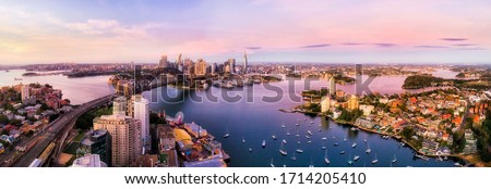 Sydney harbour and major city landmakrs around Lavender bay in aerial panorama at sunrise. #1714205410