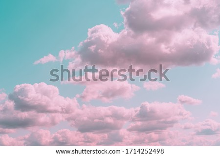 Aesthetic background with beautiful turquoise sky with pink clouds and circle light frame. Minimal creative concept of angel paradise #1714252498
