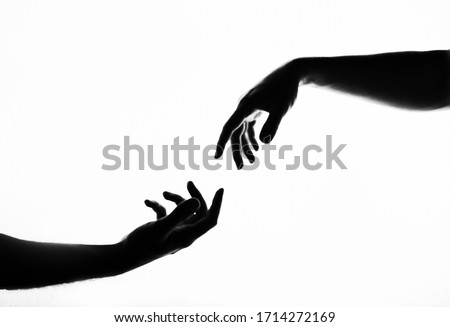 Finger Touching hands silhouette man woman white background couple feeling love. Black and white photo picture. Hands. Shadow. Black and white photo. Life. Love.   Royalty-Free Stock Photo #1714272169