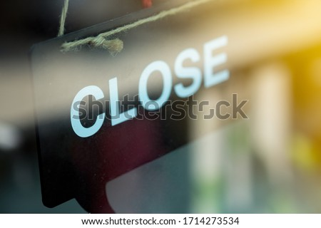 Close sign on black wooden hanging on door at coffee shop #1714273534