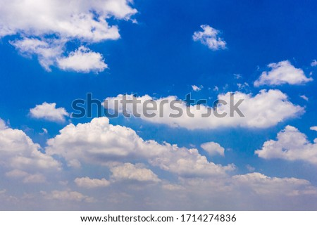White clouds cumulus floating on blue sky for backgrounds concept Royalty-Free Stock Photo #1714274836
