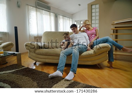 happy young family with kids in bright modern living room have fun and looking big flat lcd tv #171430286