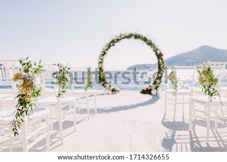 WEDDING ARCH RECEPTION WITH SEA VIEW in Montenegro. White wedding reception venue with sea and mountains view. Destination wedding venue. Royalty-Free Stock Photo #1714326655