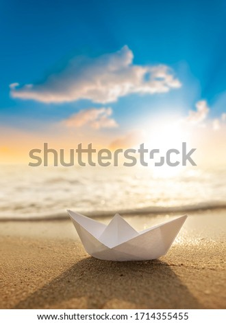 A paper boat on a beautiful beach  #1714355455