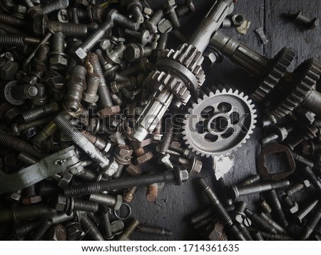 Old gears and old nut on wooden tables   Royalty-Free Stock Photo #1714361635