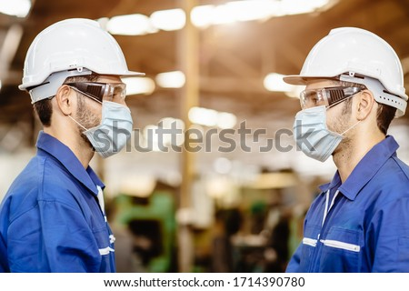 Worker wear face mask standing distancing during talking together service working in factory to prevent Covid-19 virus air dust pollution and for good healthy. #1714390780