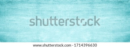 Abstract turquoise bright wood texture on blue light natural color background Art plain simple peel wooden floor grain. Green mint teak old panel backdrop detail streak finishing for white space Royalty-Free Stock Photo #1714396630