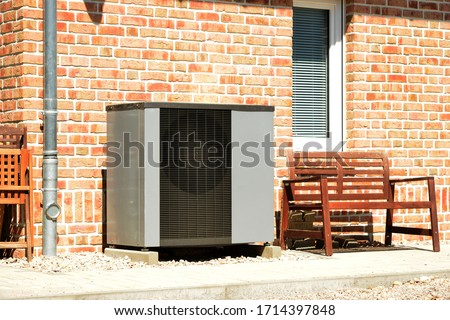 Air-Air Heat Pump for Heating and hot Water in Front of an Apartment Building Royalty-Free Stock Photo #1714397848